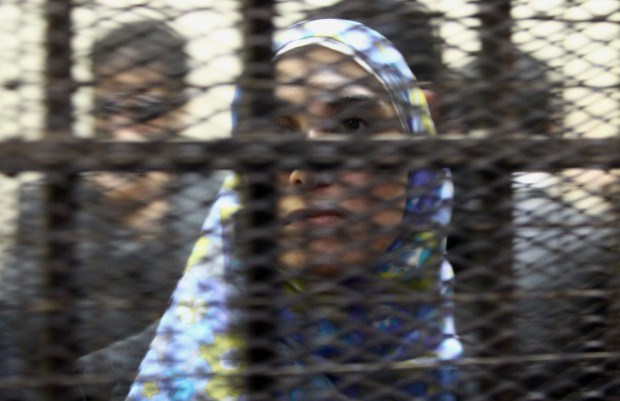 One of the fourteen Egyptian NGO workers accused of receiving illegal foreign funding stands inside a cage during the trial in Cairo on February 26, 2012. KHALED DESOUKI/AFP/GettyImages