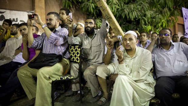 Supporters of the Salafist Al-Nour Party watch a speech given by popular Salafi religious leader Mohamed Hassan in Cairo, Egypt, on October 14, 2011. (David Degner/Getty Images)